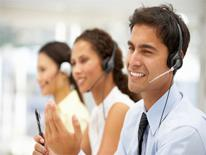 Man and two women on the phone in a call center